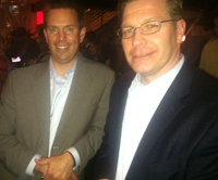 Two drink tickets, no waiting: Vendor parties made up for T3's no-frills vibe. Here, advisors Dan Skiles and Mark Avers of Shareholders Service Group Inc. at the hopping Black Diamond party.