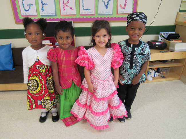 Children dressed in clothing reflecting their Families' heritage.