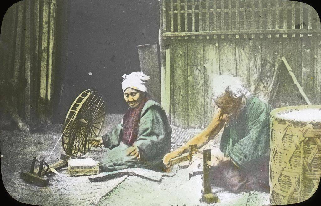 Japanese farmers spinning cotton in their home