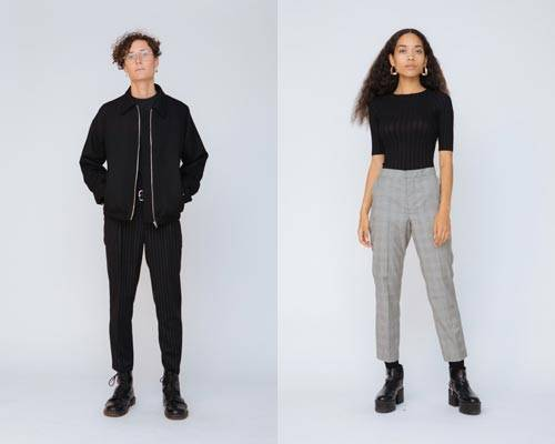 Man wearing black wool jacket and black skinny trousers from sustainable fashion brand Hund Hund and woman wearing organic cotton ribbed top with cropped grey trousers