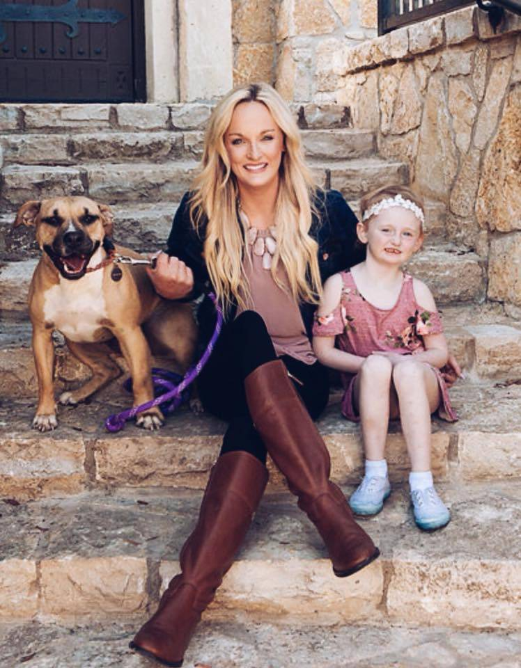 ron lyons wife crystal with reese and a rescue dog