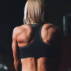 Muscular woman focusing