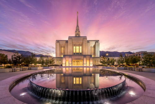 Ogden LDS Temple and reflection pool against a purple and pink sky.