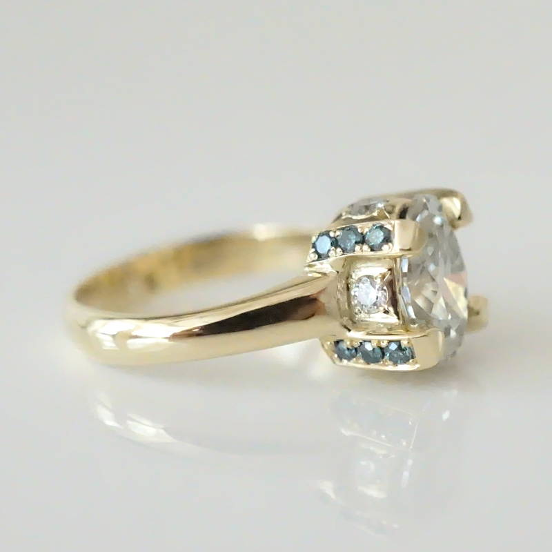 oval diamond engagement ring with blue diamonds