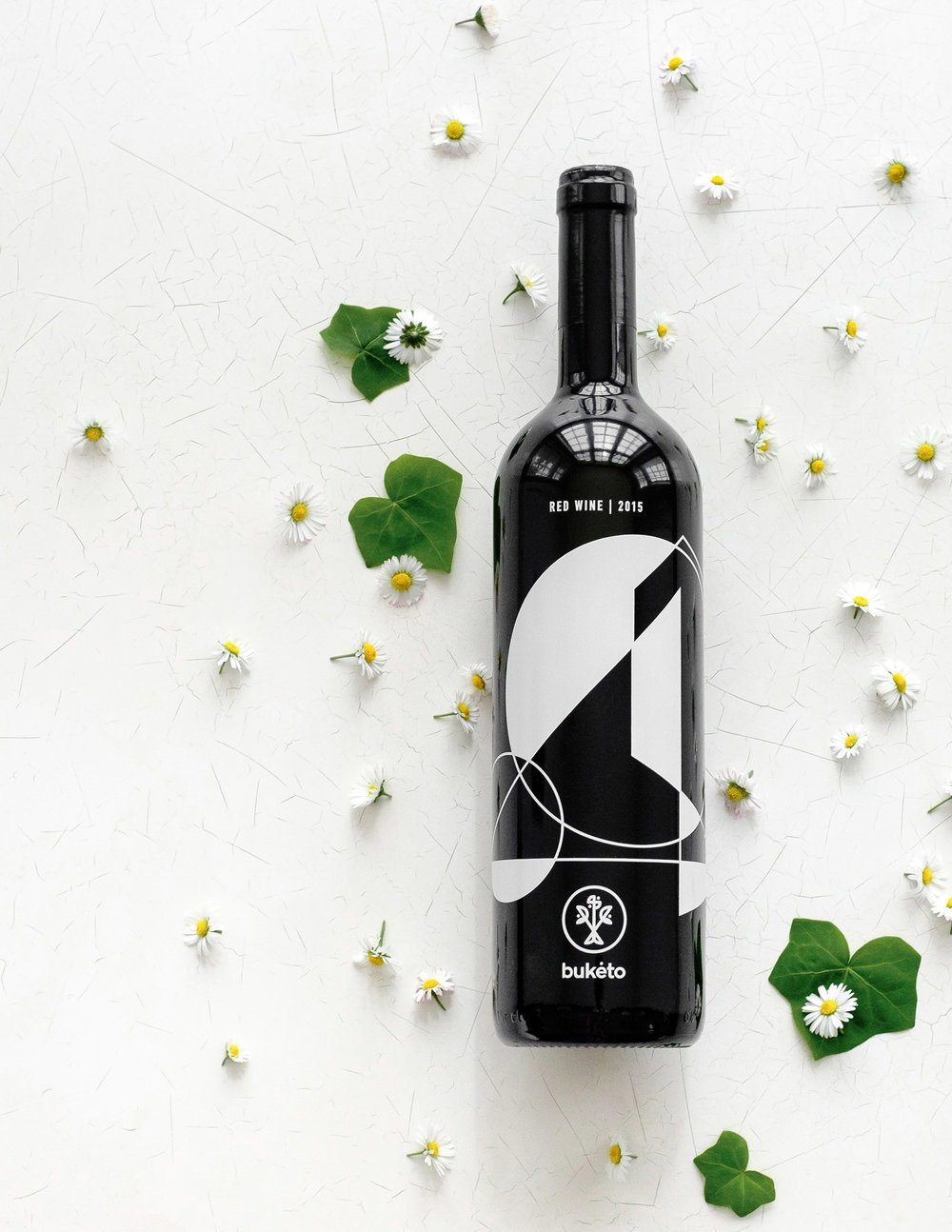 Buketo Red wine design by Lazy snail Design