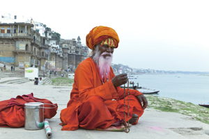 Join the magical moment of a morning prayer by the holy river of Ganges
