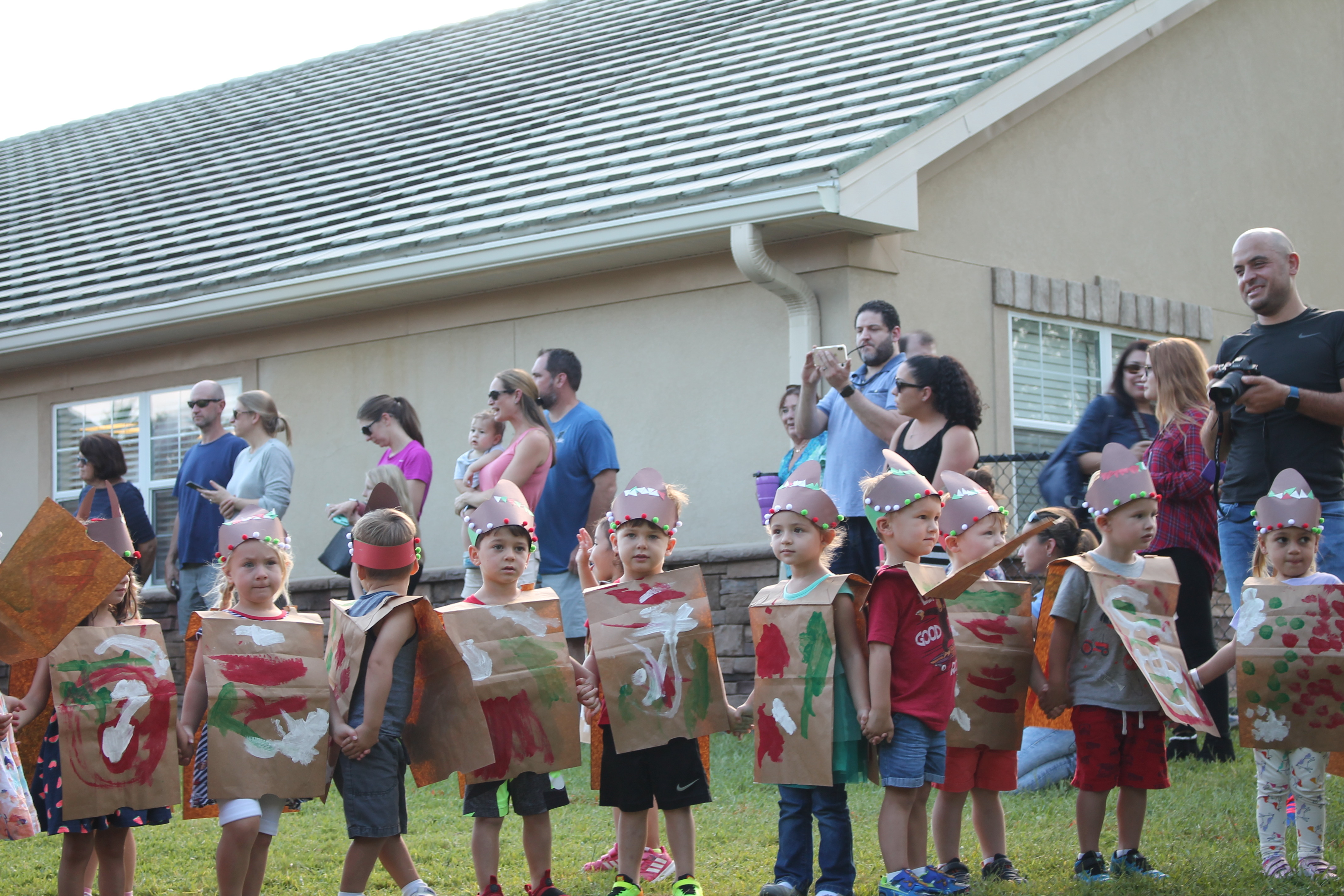 Photo of children dressed in child-created costumes and accessories