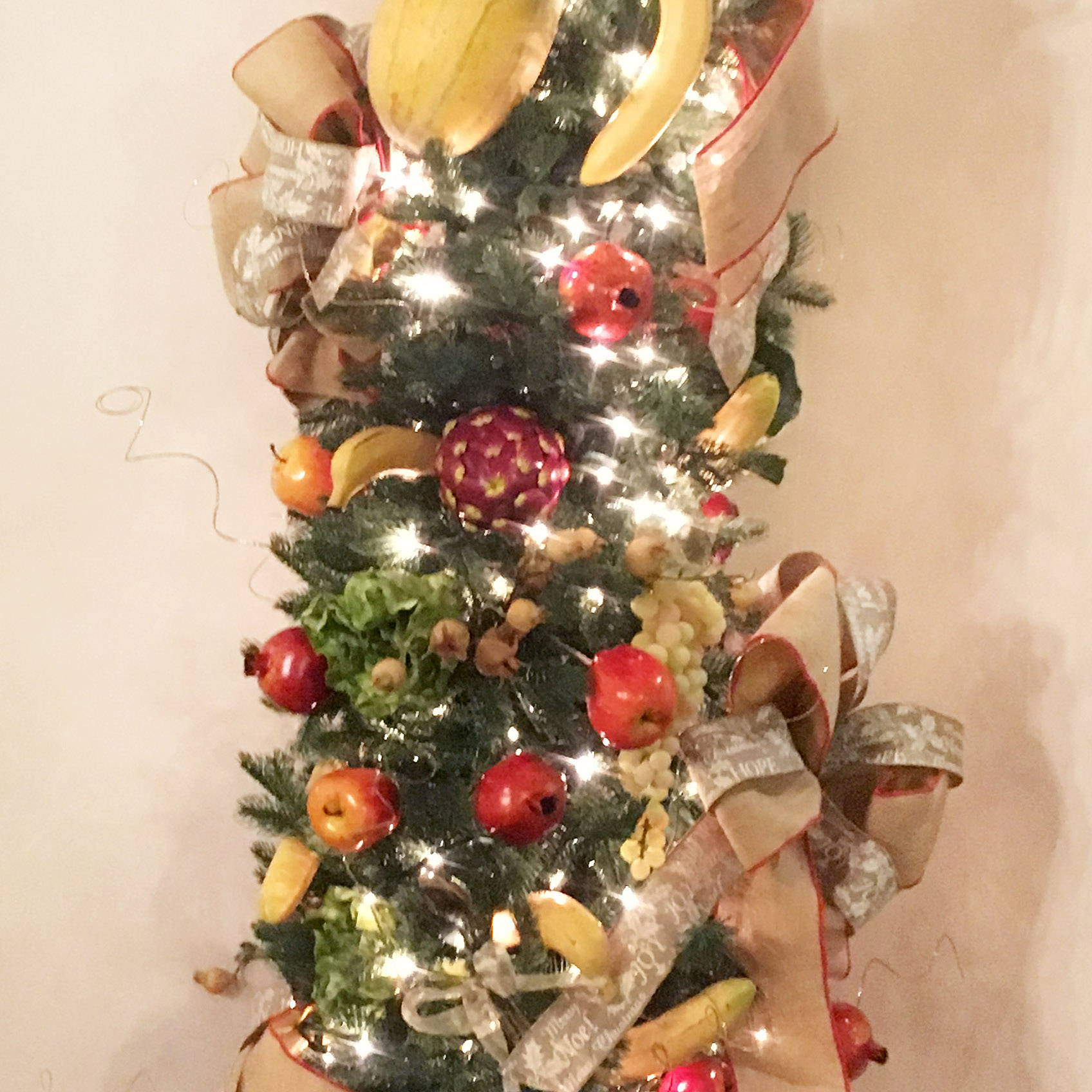 Fruit themed Christmas tree with fruit shaped ornaments