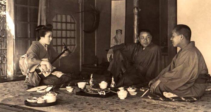 geisha entertaining two men