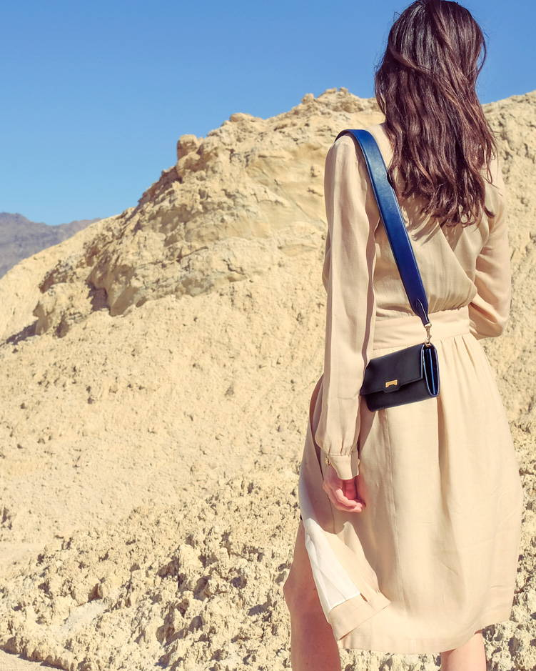 Navy blue vegan leather crossbody mini handbag wallet styled in the desert of California