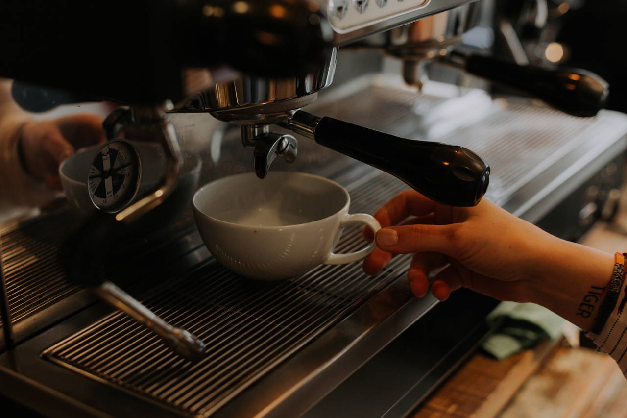 Preparation of a coffee drink at our specialty coffee shop