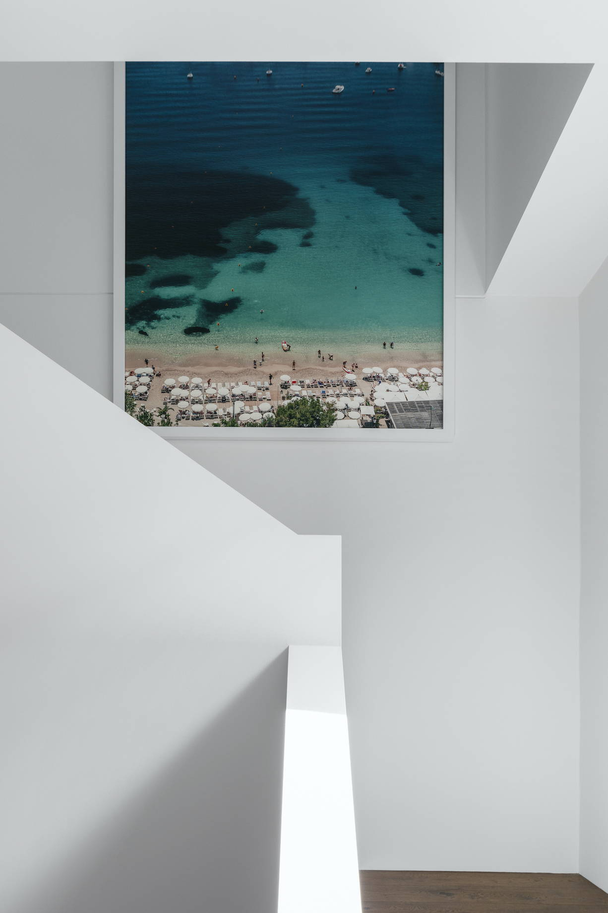 Aerial travel photography framed in a white modern stairwell