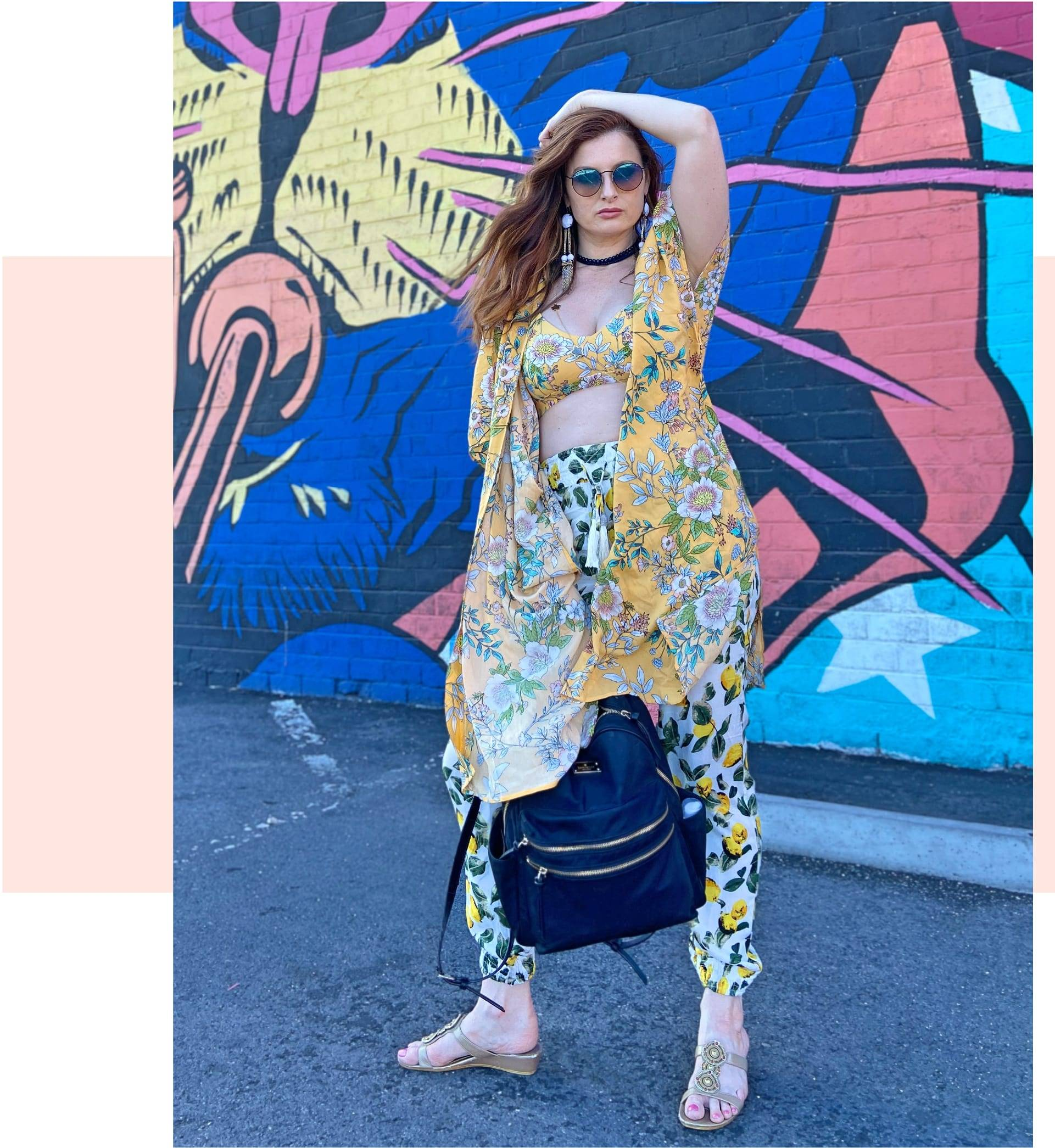 Rachel Reilly is wearing SKYE's Liz top and Nelly kimono from the Penelope collection.