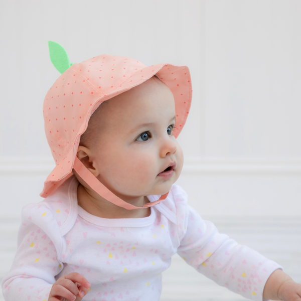child with infant girl hats