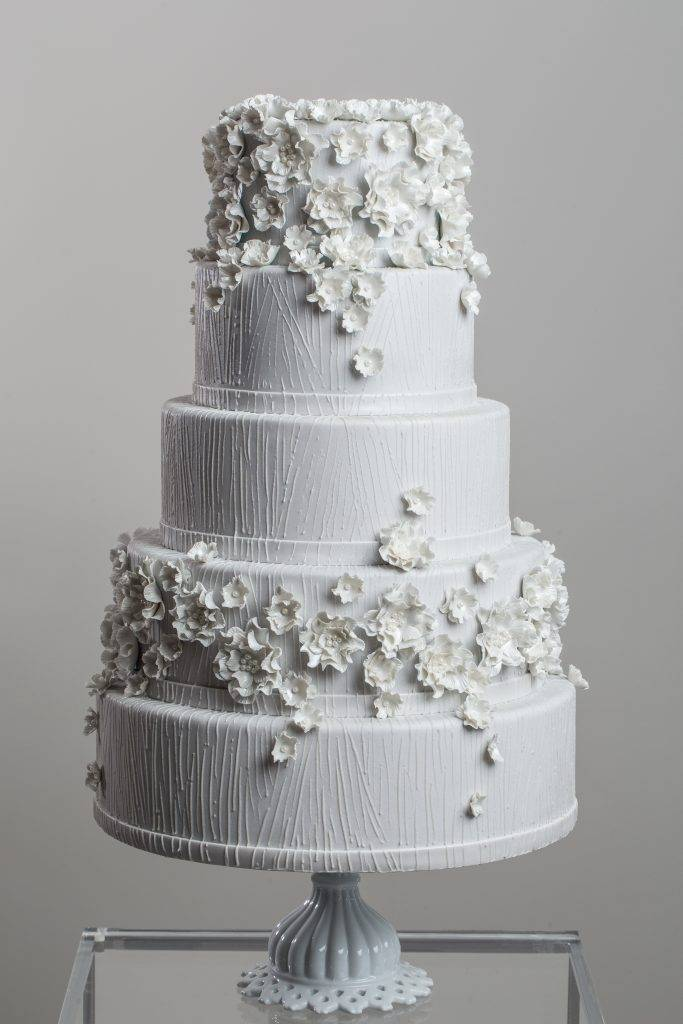 White wedding cake with white flower details made by House of Clarendon in Lancaster, PA