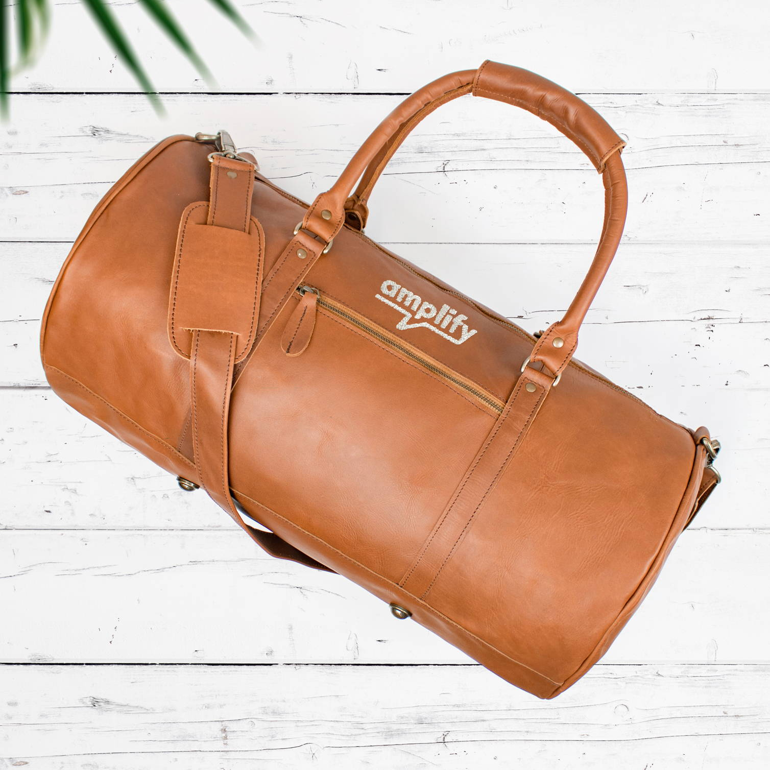 branded leather duffle bag
