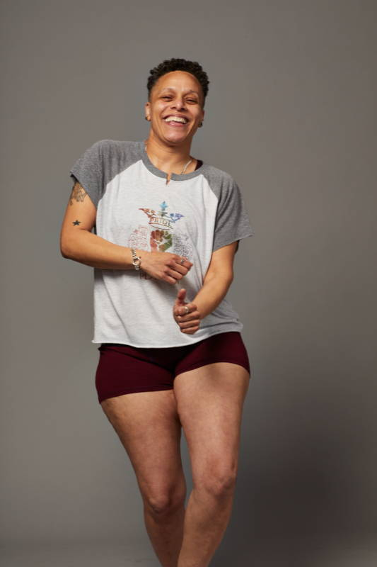 Model wears Play Out LGBT Pride shirt and gender-neutral low-rise boxer briefs.