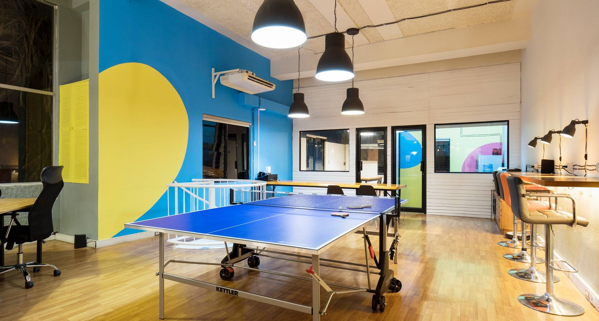 office start up space with a ping pong table in the middle