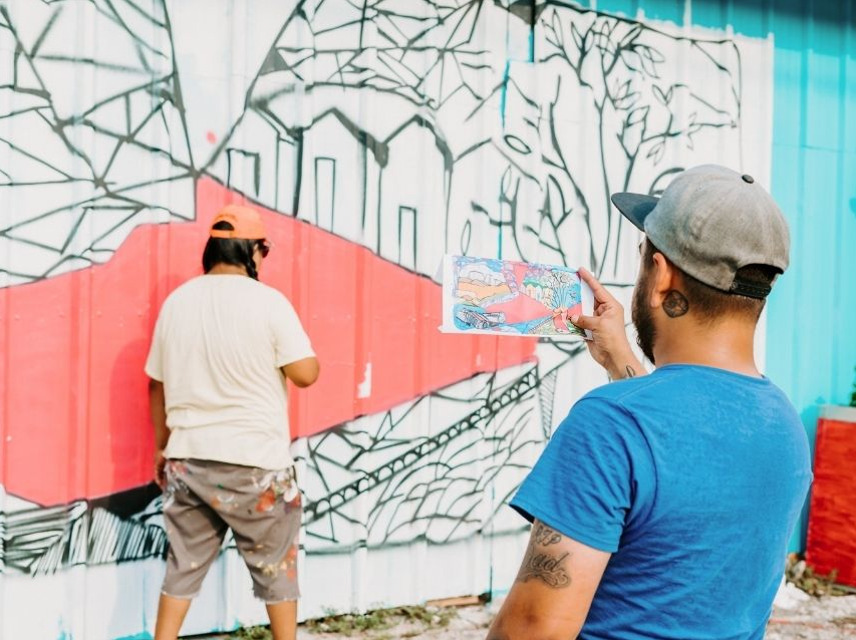 Community Mural at Wicho's being painted.