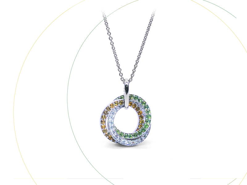 round white gold pendant with three stone hoops; citrines, emeralds and diamonds.