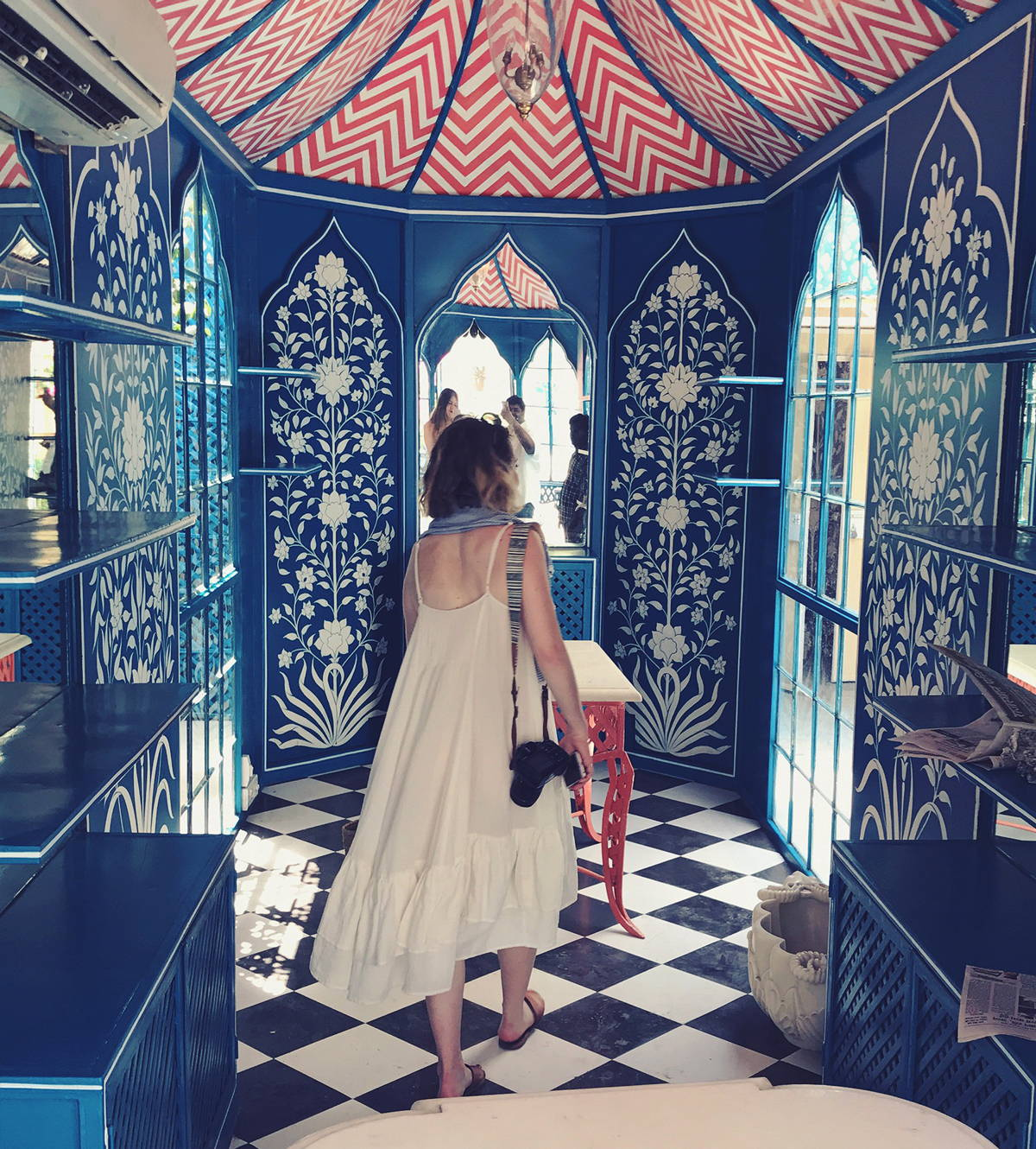 Photo of our designer Meghan in India walking through a beautiful building.