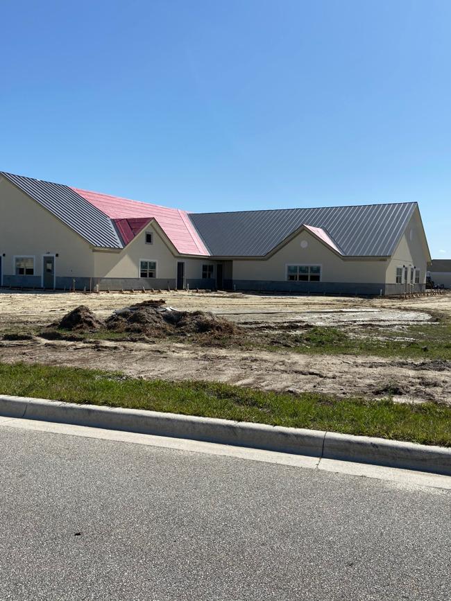 metal roof panels being laid