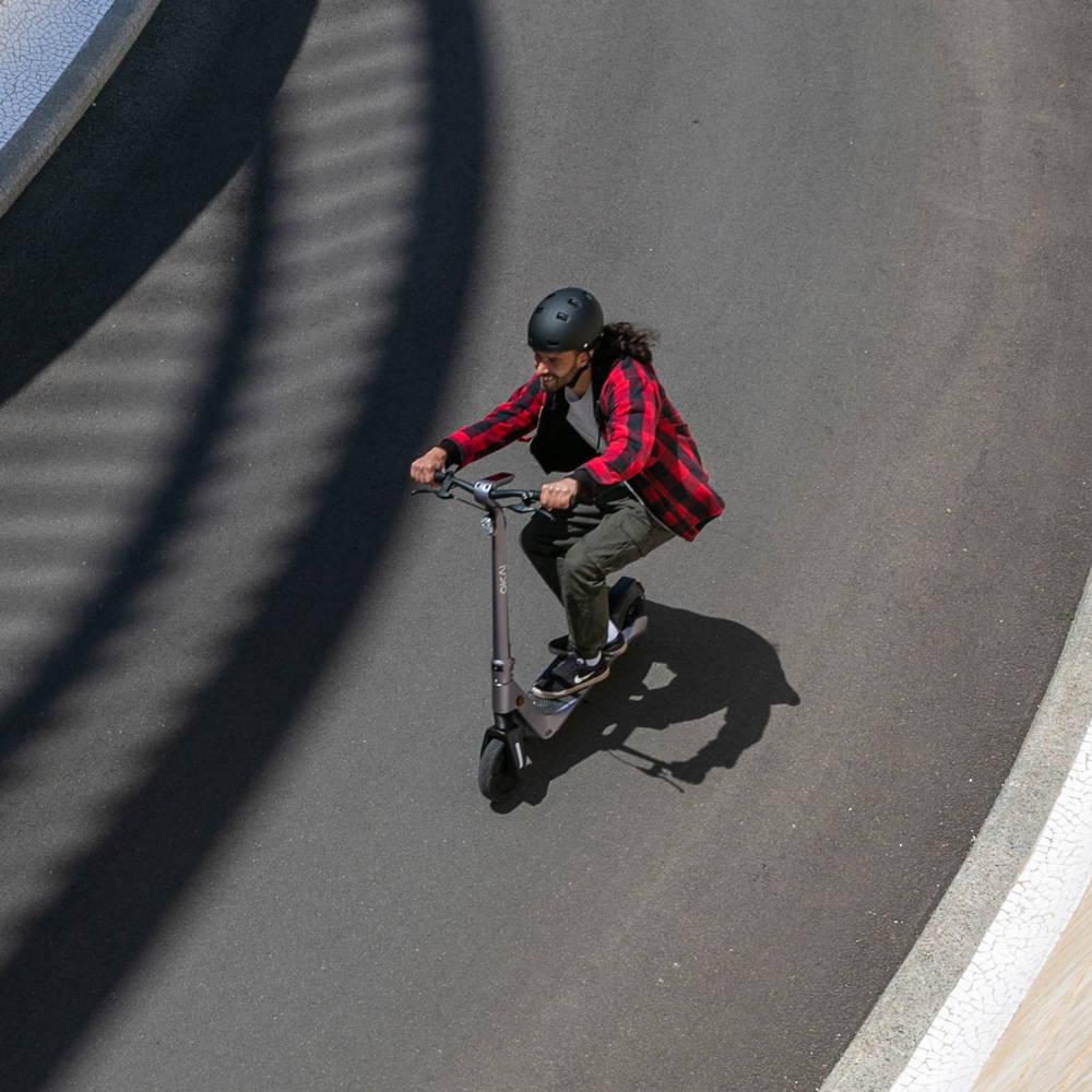 Okai ES500 Electric Scooter dude cruising downhill