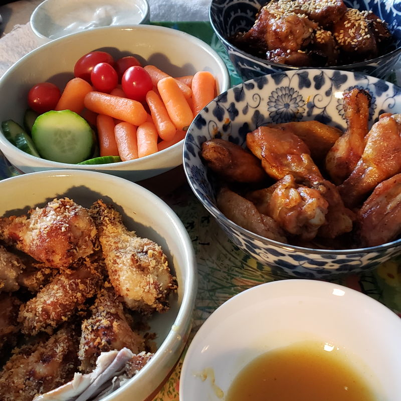 Chicken wings 3cways for Superbowl game with veggies and dip. Wings 1 honey soya sauce 2 buffalo  3 panko crusted crispy with honey mustard sauce Veggie dip sauce made from Greek yogurt with cumin and coriander,  salt pepper and lemon juice