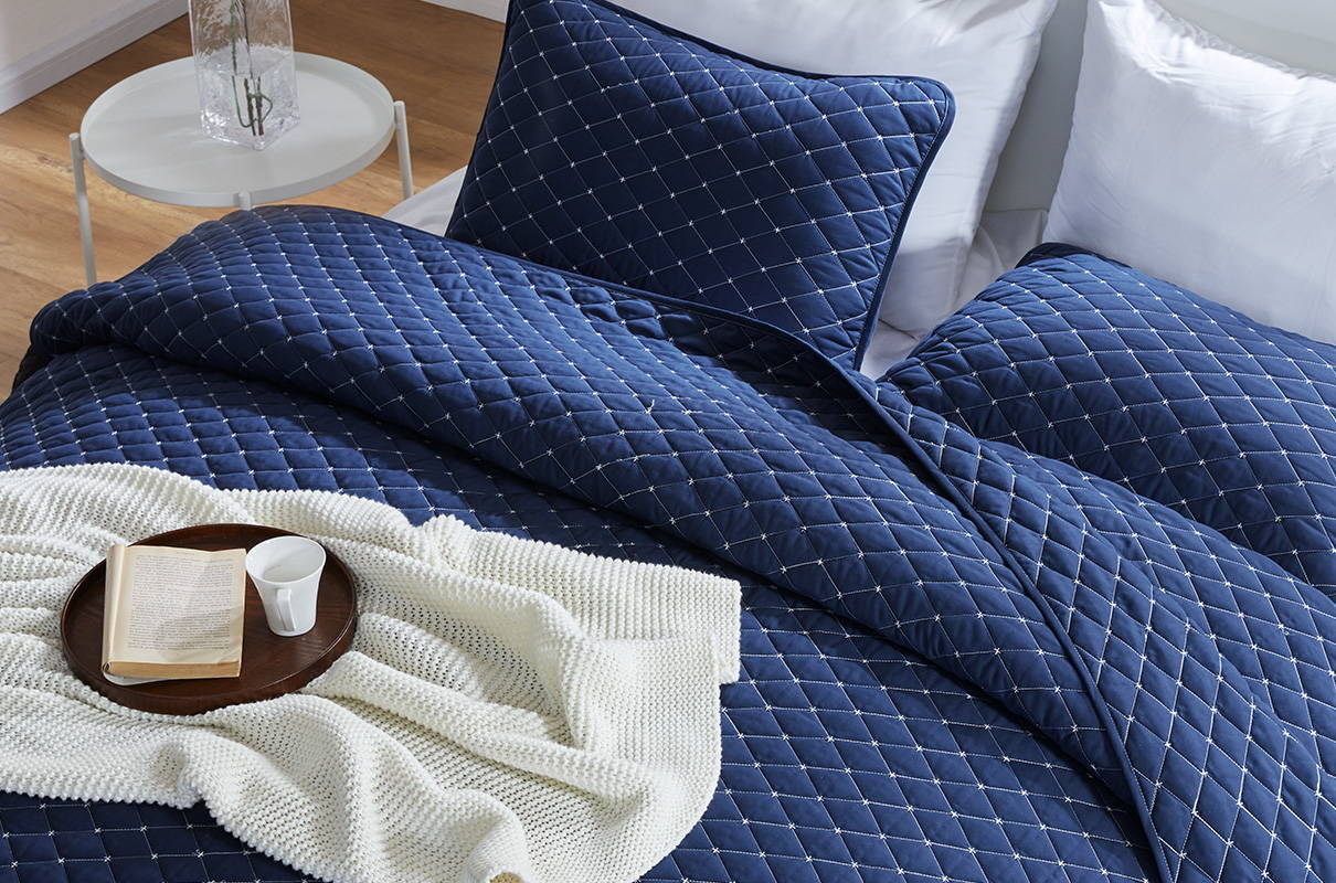sleep zone bedding website store products collections quitl set navy blue read on bed