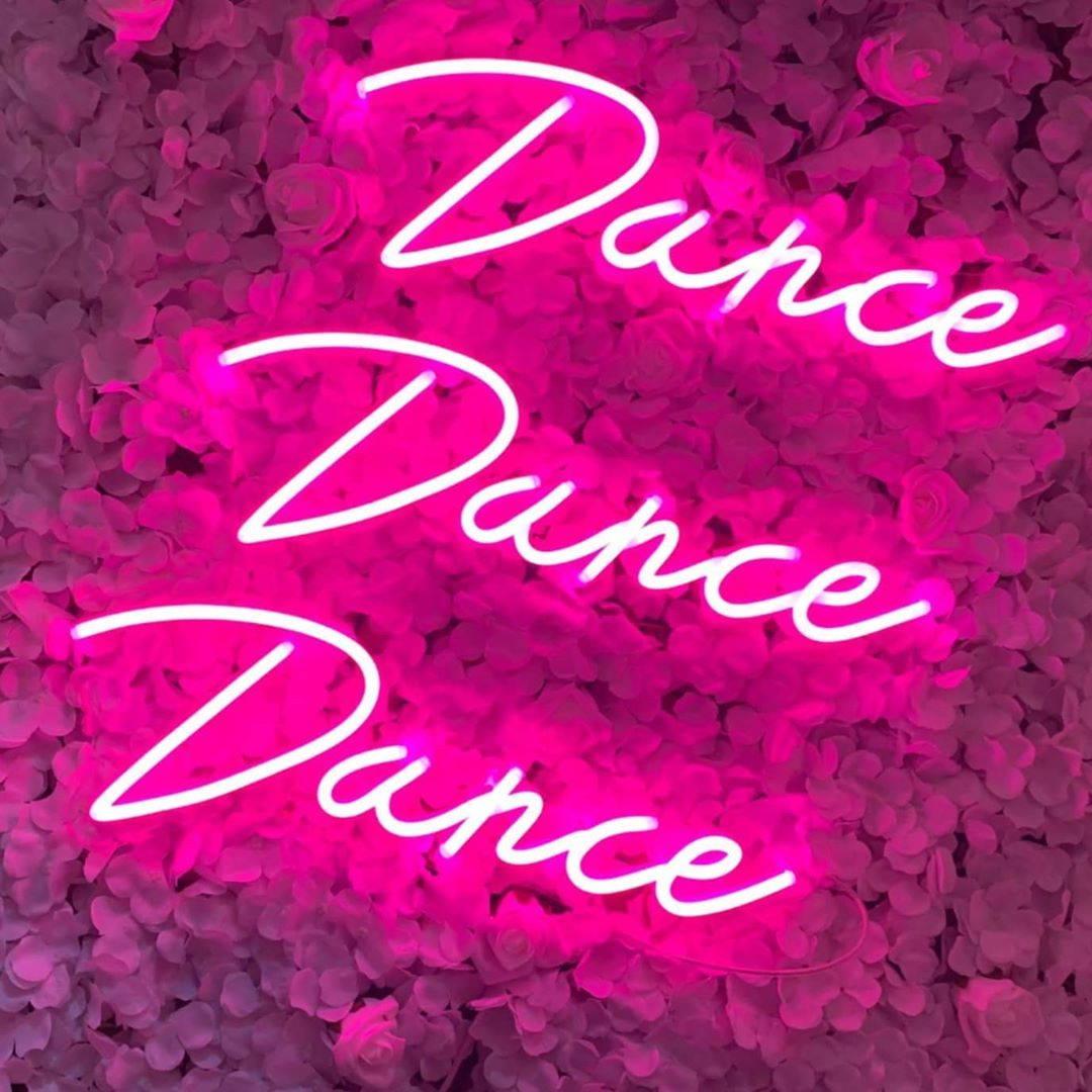 dance dance dance neon sign