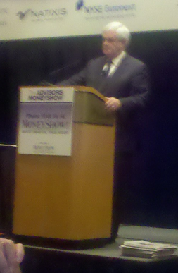 Newt Gingrich's speech was among the eclectic content and exhibitors at The Advisors MoneyShow [photo by cell phone]