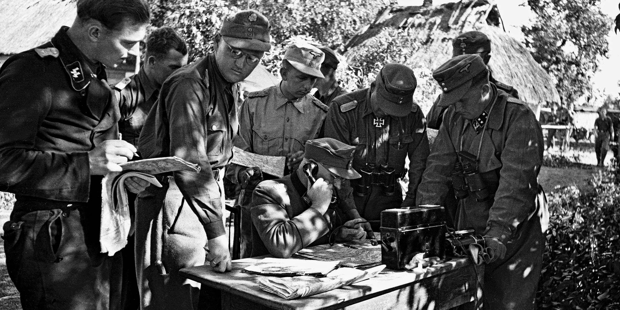 """""""Otto Gille speaks into a field phone during a commanders meeting. 22  July 1944."""""""
