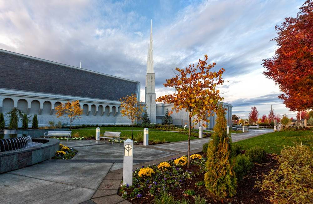 Angled photo of the Boise Idaho LDS Temple featuring the fountain and fall-colored leaves.