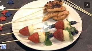 Fruit skewers and a chicken teriyaki marinated in Betsy's Best