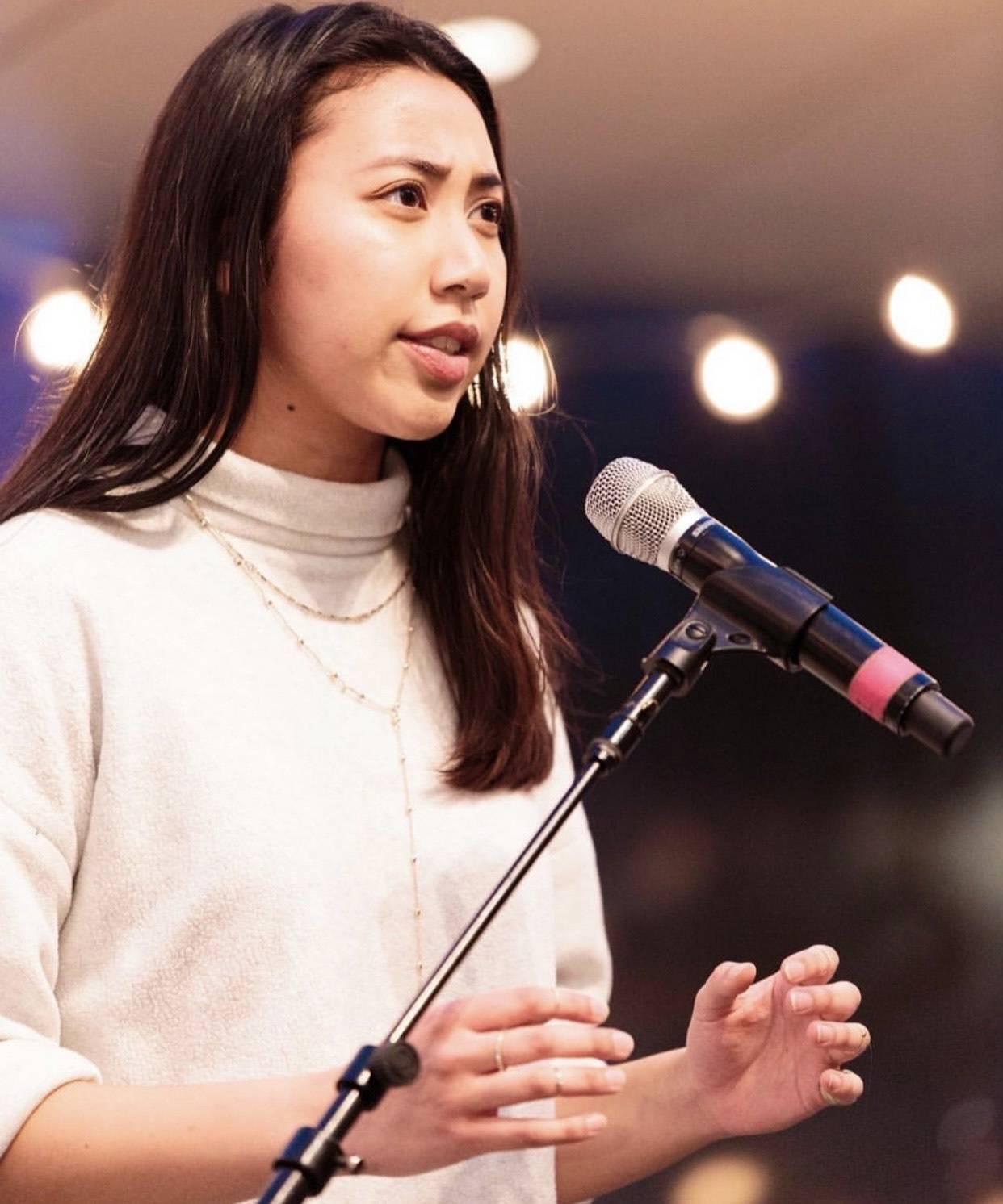 Dena Igusti with a microphone