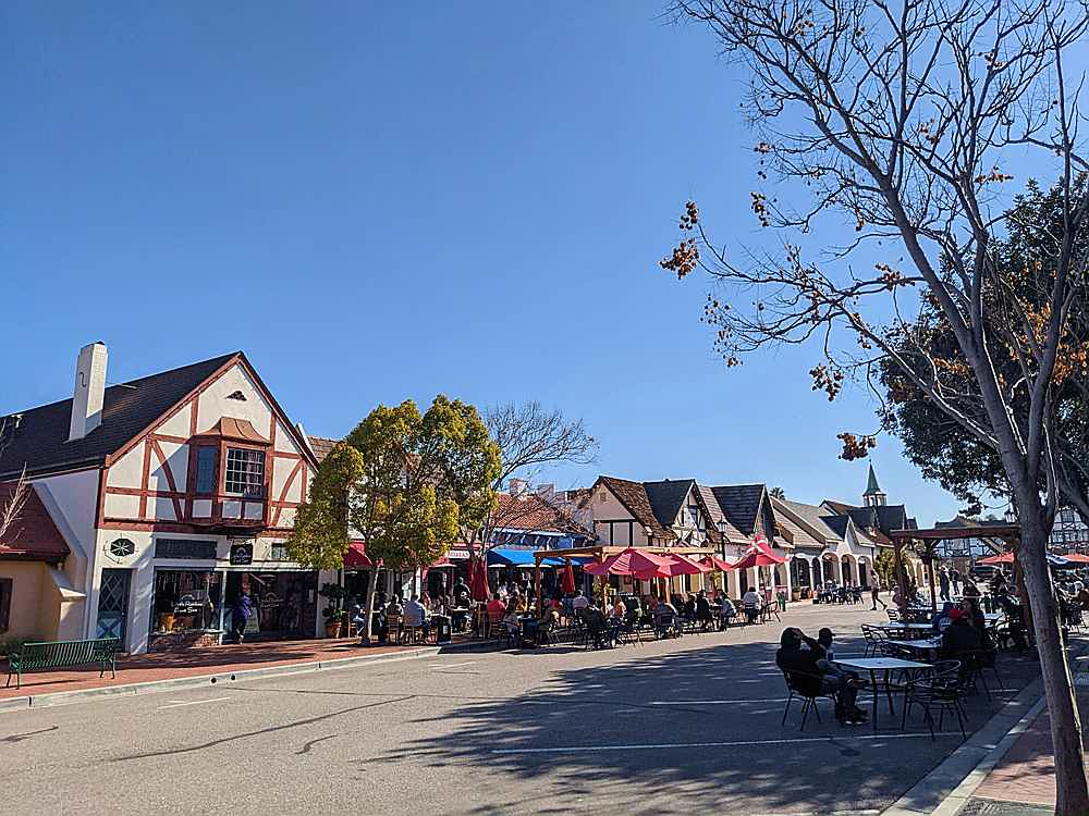 Outdoors street dining with people eating in Solvang Santa Ynez Valley