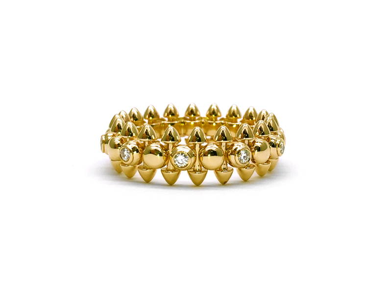 Solid yellow gold structural ring with small diamonds all around and peaks emerging at the top and bottom of the ring body