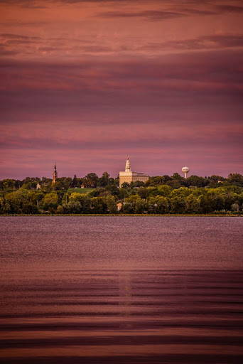 Nauvoo Temple from across a purple river against a purple sky
