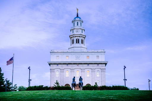 Nauvoo Temple standing against a blue and purple sky.