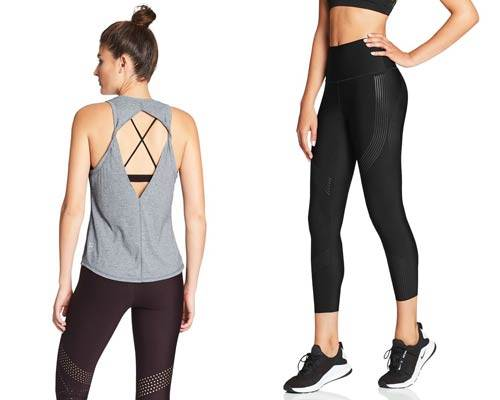 Back of woman wearing grey cut out vest with strappy sports bra detailing and woman wearing black sustainable high rise compression leggings