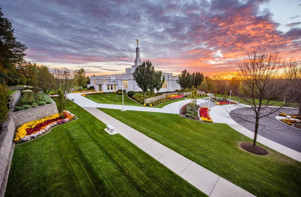 LDS art photo of the Palmyra New York Temple against a colorful sunset.
