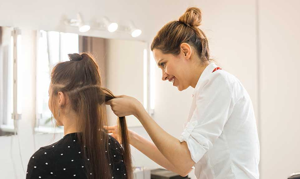 hair stylist creating an updo