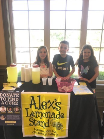 children serving lemonade