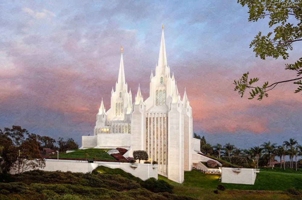San Diego Temple and lush grounds against a pastel sky.