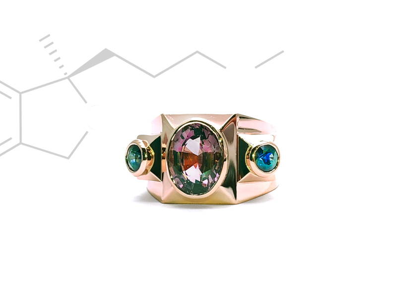 Multi-faceted structural ring in pink gold with sapphire stones in closed setting