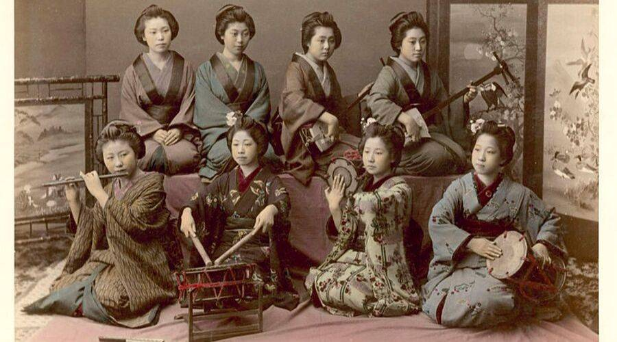 Japanese geisha in a group playing instruments