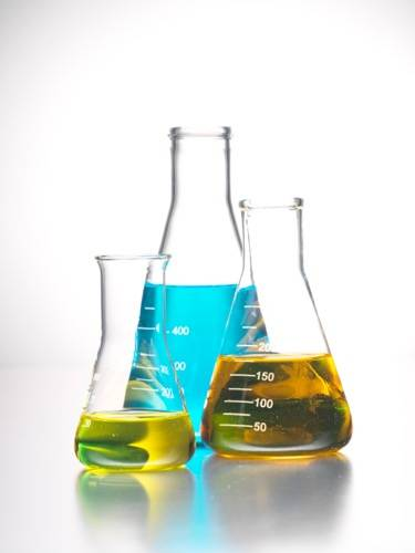 Erlenmeyer flasks filled with colored liquid