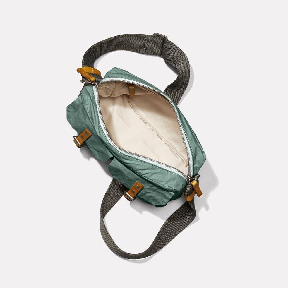 Franco Waxed Cotton Crossbody Bag in Green Interior