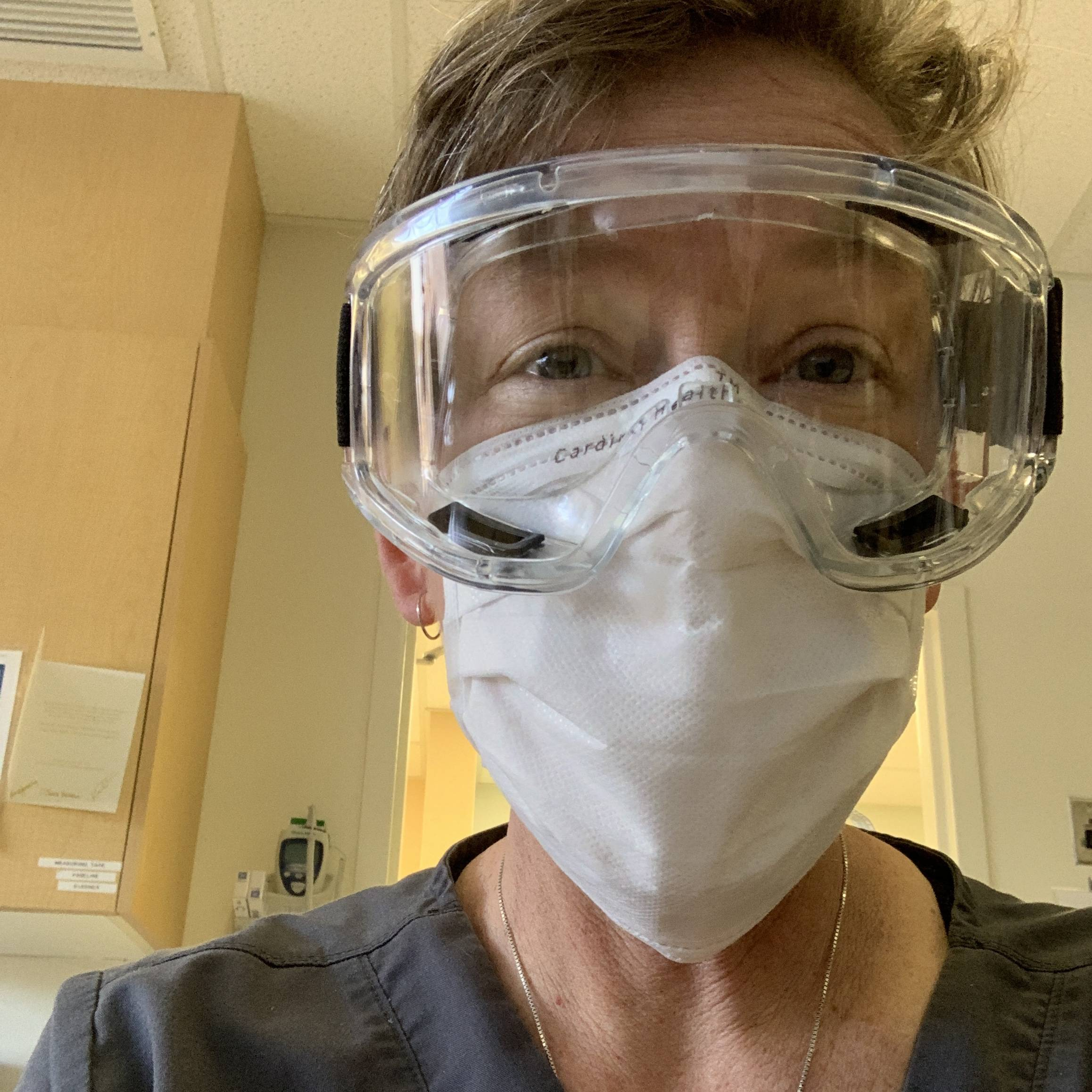 NICU Nurse Trish Ringley in PPE caring for preemies