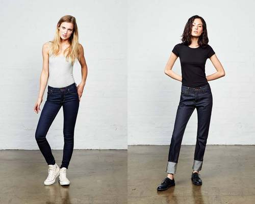 Woman wearing indigo Hiut Denim skinny fit jeans and woman wearing turned up indigo Hiut denim jeans